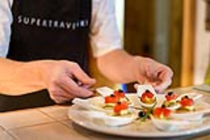 'Who's for canapes?' Supertravel chef preparing luxury level chalet food